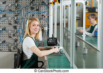 Production worker in manufacturing plant - Young female...