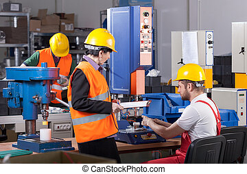 Production worker with boss - Production male worker with...