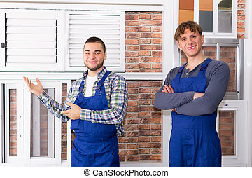 Production workers  with different PVC window with shutter