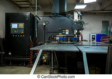 Production workshop. Machine for punching metal