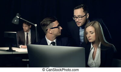 Productive Team - Team of three working at one computer and...