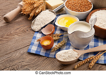 Products for cooking, still life with flour, milk, egg and wheat