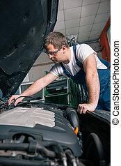 profesional, mecánico del coche, trabajando