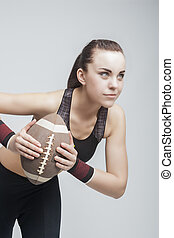 Professioanl Female Soccer Player With ball for American Football