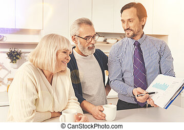 Professioanl real estate agent talking with retired couple