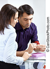 Professional advice - The girl helps the man to choose a...