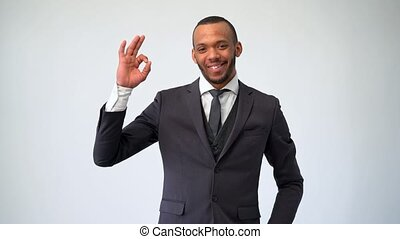 professional african-american business man - showing ok sign.
