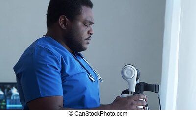 Professional african american medical doctor working in hospital office using virtual and augmented reality technology. Medicine and healthcare concept.