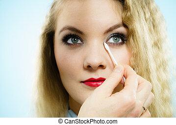 Professional artist fixing fashion model make up
