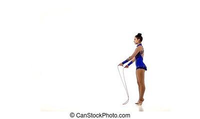 Professional artistic gymnast performs tricks, slow motion