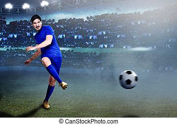 Professional asian football player pass the ball