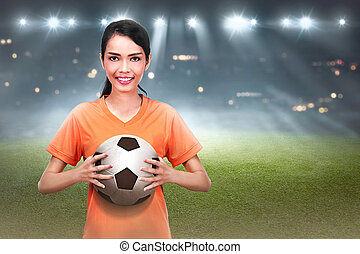 Professional asian football player woman holding the ball