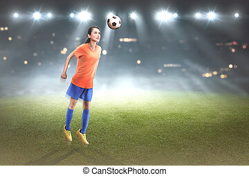 Professional asian football ployer woman jump with ball