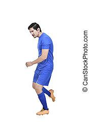 Professional asian footballer man kicking the ball
