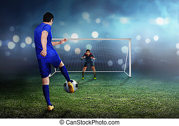 Professional asian soccer player man kick the ball to goal