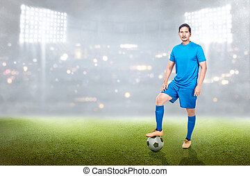 Professional asian soccer player man standing with ball on his leg