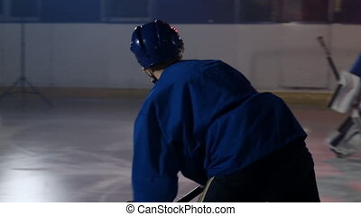Professional athlete male hockey player turns in front of...