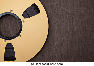 Professional audio metal reel on brown background