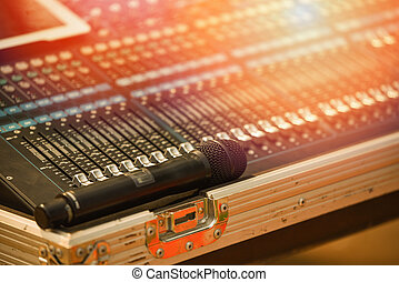 Professional audio mix sound control panel console and microphone / Sound technician and lights equipment