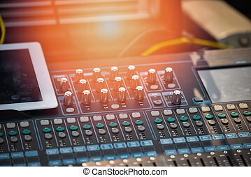 Professional audio mix sound control panel console / Sound technician and lights equipment