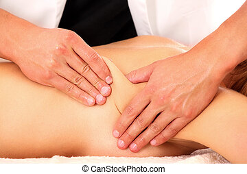 A picture of a physio therapist giving a back massage