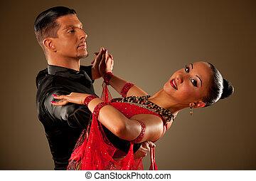Professional ballroom dance couple preform an romantic...