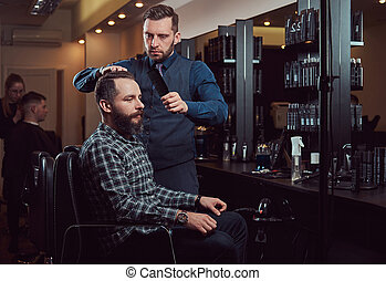 Professional barber working with a client in a hairdressing salon.