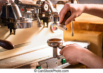 Professional barista going to make coffee