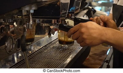 Professional barista prepares a cappuccino in a busy coffee...