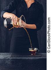 Professional barista preparing coffee alternative method
