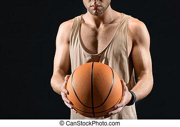 Professional basketball player holding ball