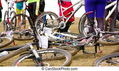 Professional Bicycles On The Ground While Sportsmen Preparing For Competition