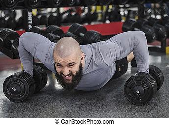 Professional bodybuilder doing push-up exercise, sports training , lifestyle