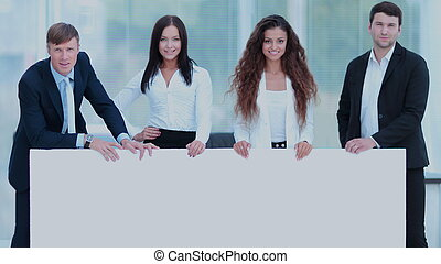professional business team holding a large blank white poster
