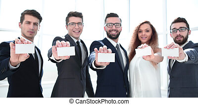 professional business team showing their business cards