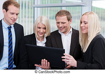 Professional business team using a laptop