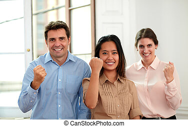 Professional business team with victory sign