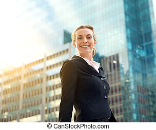 Professional business woman smiling outside in the city