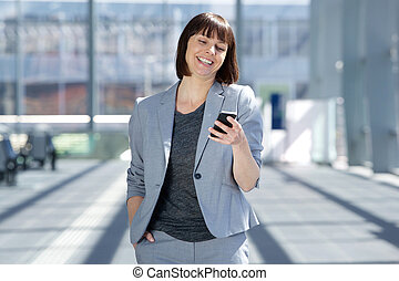 Professional business woman smiling with cell phone