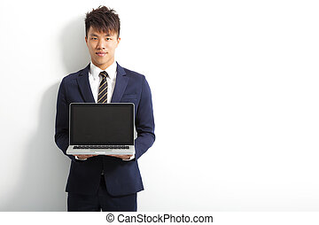 professional businessman using a laptop to do