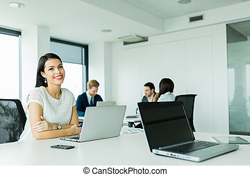 Professional businesswoman sitting at an office desk