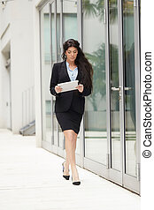 professional businesswoman working in urban environment