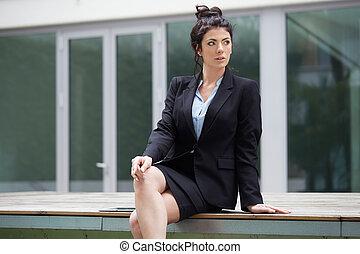 professional businesswoman working in urban environment
