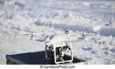 Professional Camera Drone flying on case.