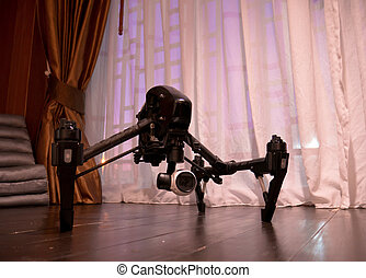Professional camera drone on wooden floor.
