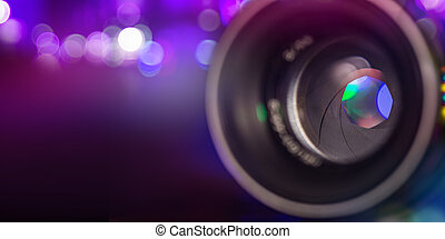 Professional camera lens with reflections.