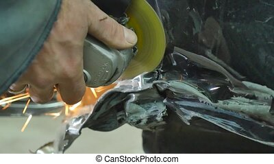 Professional car body repair with special equipment.