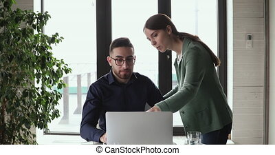 Professional caucasian female mentor training arabic male ...