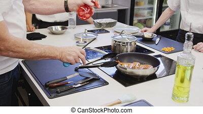Professional Caucasian male chef in a restaurant kitchen ...