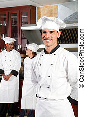 professional chefs in - happy male professional chefs in...
